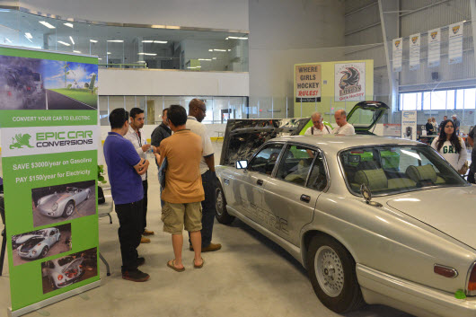 A View of Epic Car Conversion Jaguar EV and visitors digging for EV Conversion Information at EV Fest 2014